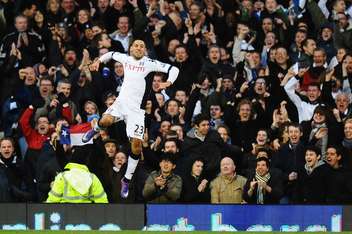LONDON, ENGLAND - JANUARY 21: Clint Dempsey of Fulham celebrates a goal during the Barclays Premier League match between Fulham and Newcastle United at Craven Cottage on January 21, 2012 in London, England.  (Photo by Mike Hewitt/Getty Images)