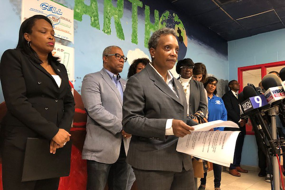 Mayor Lori Lightfoot talks to reporters about the teachers strike earlier this week. To the mayor's far left is Schools CEO Janice Jackson. Next to Jackson is Ald. Walter Burnett (27th).