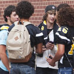 Union High School football players talk after receiving their jerseys back Wednesday, Sept. 25, 2013. Nine players were told they wouldn't be playing in Friday's Homecoming game. The football coaches at Union High in Roosevelt have taken a stand against poor performance in the classroom and bullying outside the classroom, including disrespect of teachers and students.