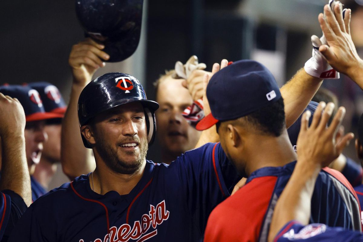 Trevor Plouffe celebrates his team-leading 19th homerun with teammates Justin Morneau and Francisco Liriano looking on.