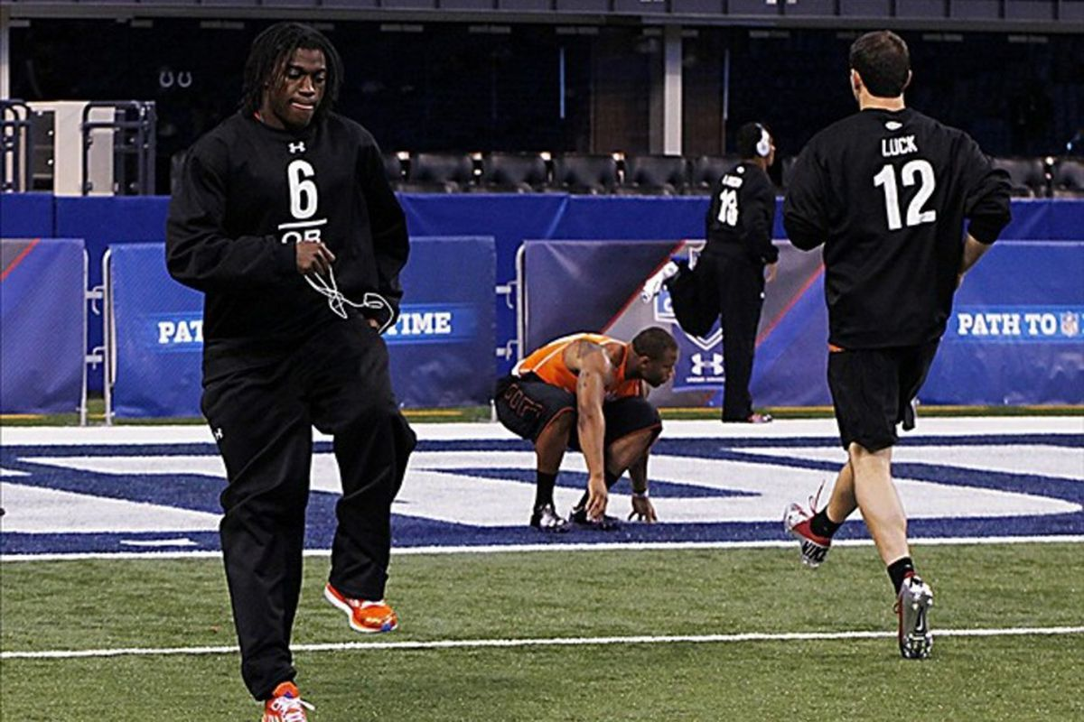 Feb 26, 2012; Indianapolis, IN, USA; Baylor Bears quarterback Robert Griffin III and Stanford quarterback Andrew Luck warm up during the NFL Combine at Lucas Oil Stadium. Mandatory Credit: Brian Spurlock-US PRESSWIRE