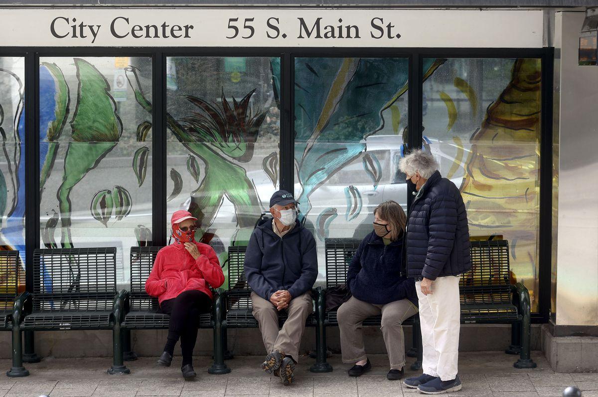 Judy Hamblin, left, Ron Hamblin, Barbara Mason and Brian Mason wear masks while waiting for TRAX in downtown Salt Lake City on Wednesday, March 24, 2021.