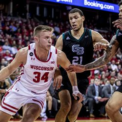 Brad Davison going around two defenders on the way to 15 points Thursday evening.