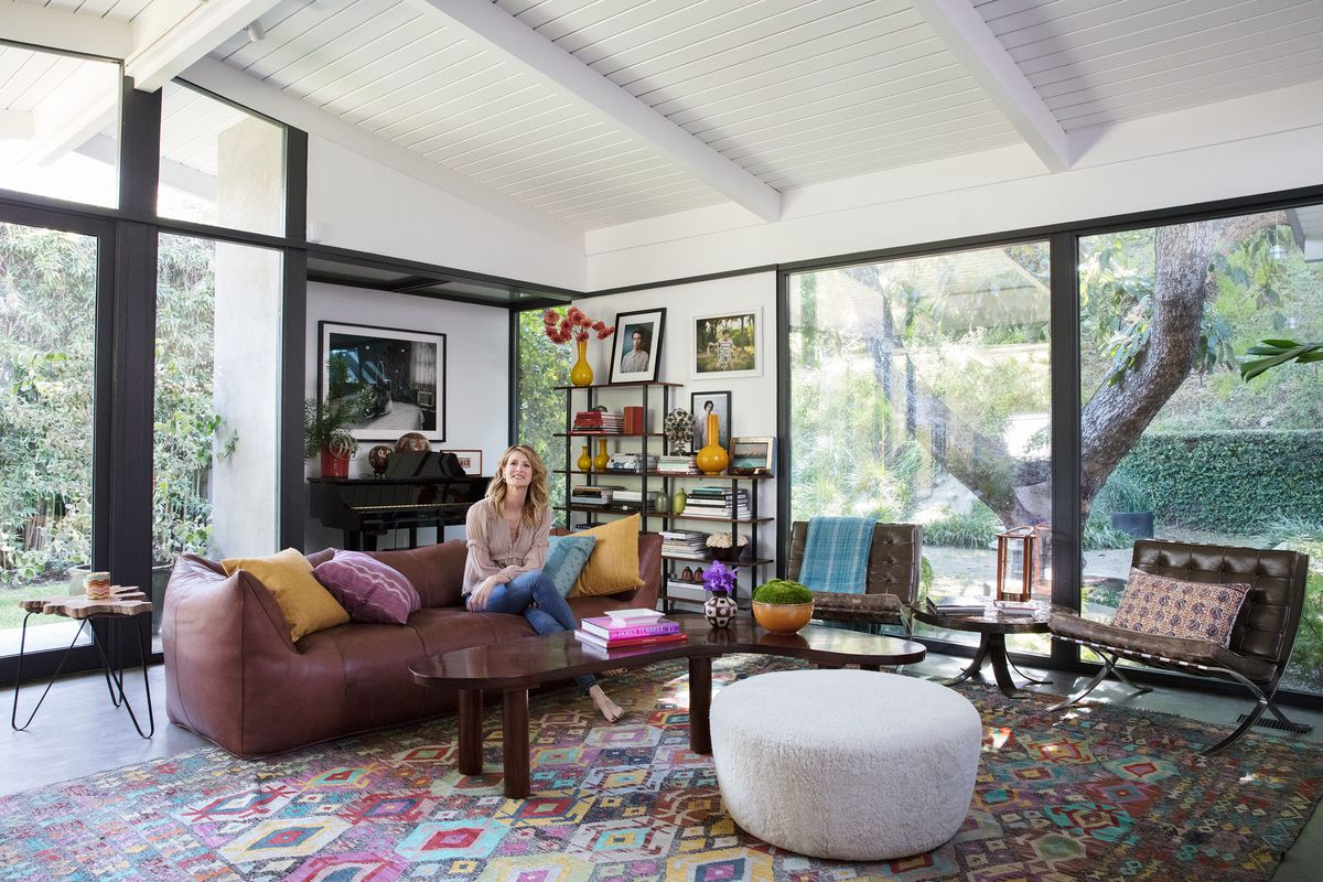 A photo of Laura Dern in the living room of her home.