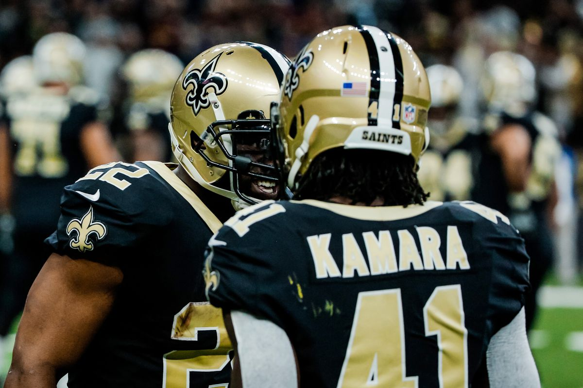 NEW ORLEANS, LA:  New Orleans Saints running back Alvin Kamara (41) celebrates a touchdown scored by teammate Mark Ingram (22) against the Washington defense at the Mercedes-Benz Superdome.
