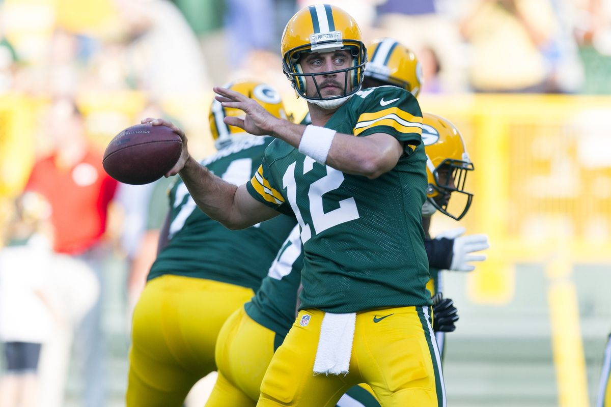 Aug 30, 2012; Green Bay, WI, USA; Green Bay Packers quarterback Aaron Rodgers (12) throws a pass during warmups prior to the game against the Kansas City Chiefs at Lambeau Field.  Mandatory Credit: Jeff Hanisch-US PRESSWIRE
