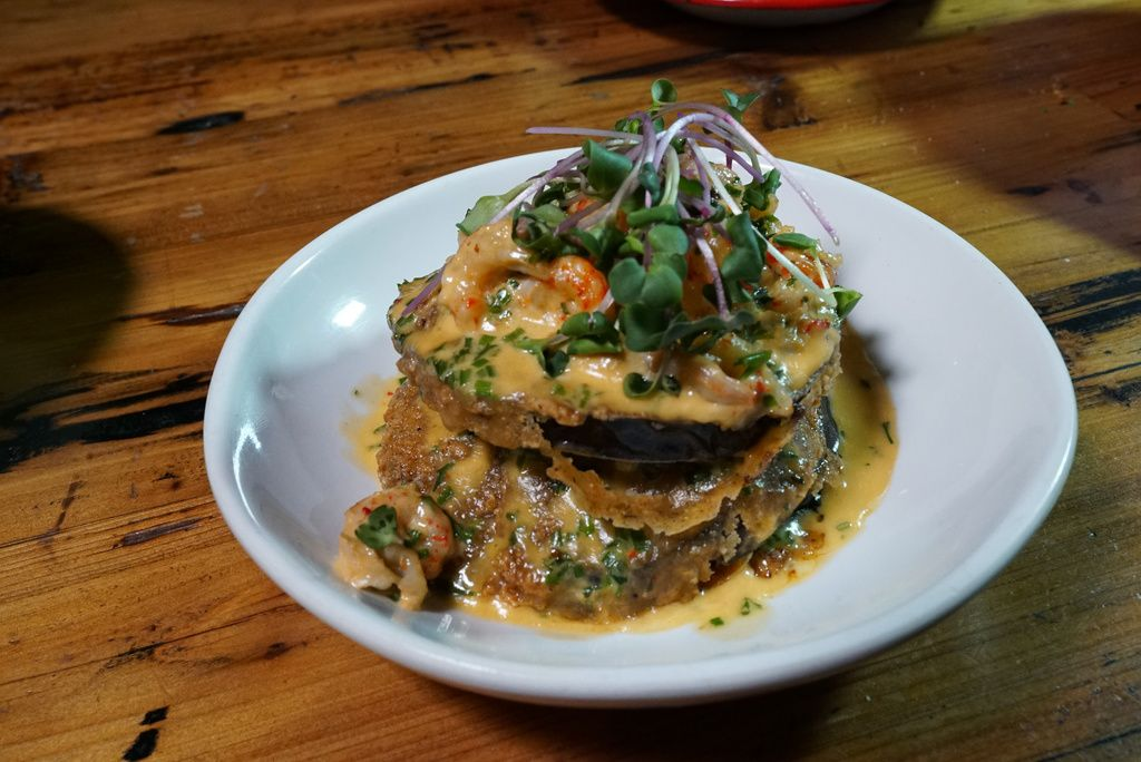 Eggplant Orleans, made at Ina Mae Tavern, is topped with crawfish beurre blanc, and fine herbs.
