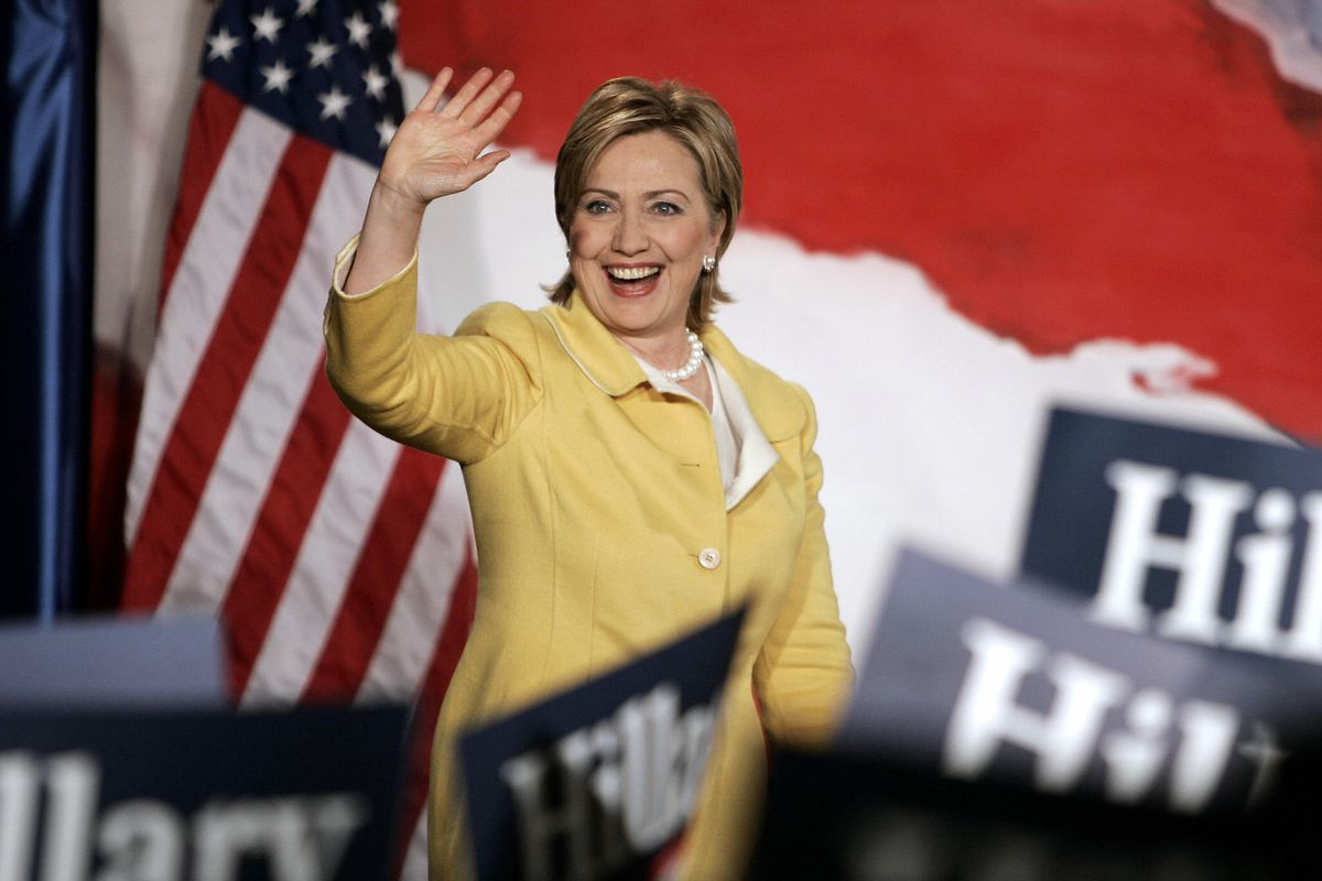 Hillary Clinton waves to her opponents from afar, since she won't be seeing them very often on the debate stage.