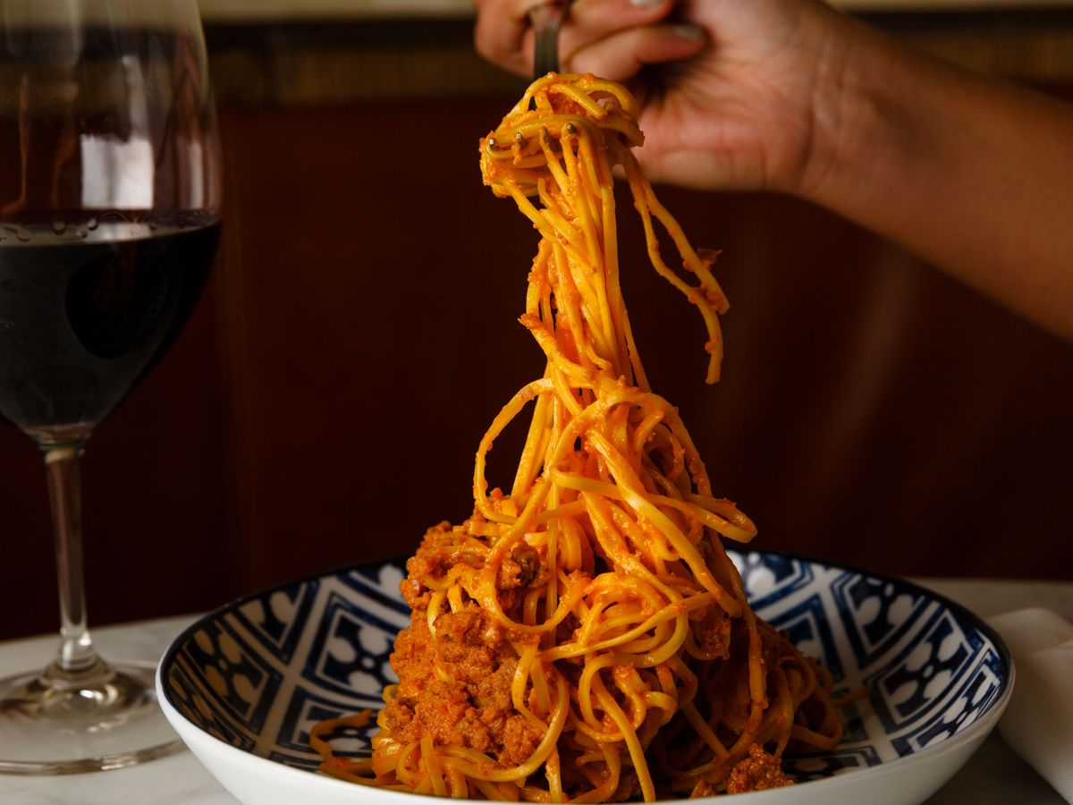The tagliolini al ragu, held up by a fork, at Rezdora
