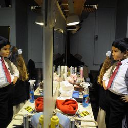 """Ashton Renstrom checks himself out in the mirror prior to the show """"The Best Christmas Pageant Ever"""" at the Valley Center Playhouse in Lindon on Thursday, Dec. 12, 2013. Owners Keith and Jody Renstrom are closing the playhouse on Dec. 21 after 38 years of community theater."""