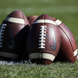 Footballs are stacked as Brigham Young University and San Jose State University prepare to face each other in NCAA football in Provo on Saturday, Oct. 28, 2017.