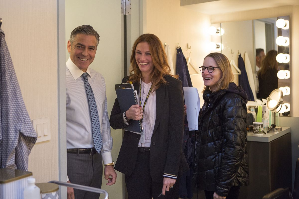 """George Clooney and Julia Roberts share a laugh with director Jodie Foster on the set of """"Money Monster.""""   TriStar Pictures"""