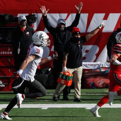 Utah Utes wide receiver Britain Covey (18) carries the ball and runs into the end zone for a touchdown during an NCAA football game at Rice-Eccles Stadium in Salt Lake City on Saturday, Dec. 19, 2020.