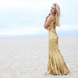 "Shea of <a href=""http://peaceloveshea.com/"">Peace Love Shea</a> is wearing a <a href=""http://www.renttherunway.com/shop/designers/zaczacposen_dresses/goodgoldgown"">Zac by Zac Posen X MAGNUM Gold?!</a> gown."