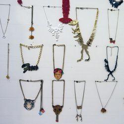 "Laser-cut necklaces from UK accessories brand <a href=""www.tattydevine.com/"">Tatty Devine</a>"