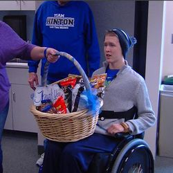"""Josh Hinton returned to Utah Valley Regional Medical Center in Provo on Thursday, Jan. 7, 2016, to thank the people who saved his life after he broke his neck on Aug. 29, 2015. His mother, Jen Hinton, holds a basket containing Josh's favorite treats. The treats were a small gesture for the staff to say """"Thanks for saving my life."""""""