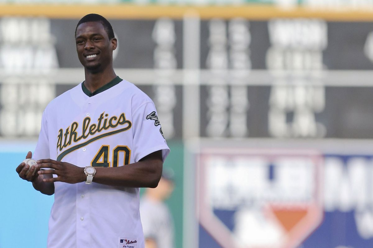 Harrison Barnes gets ready to throw out the first pitch.