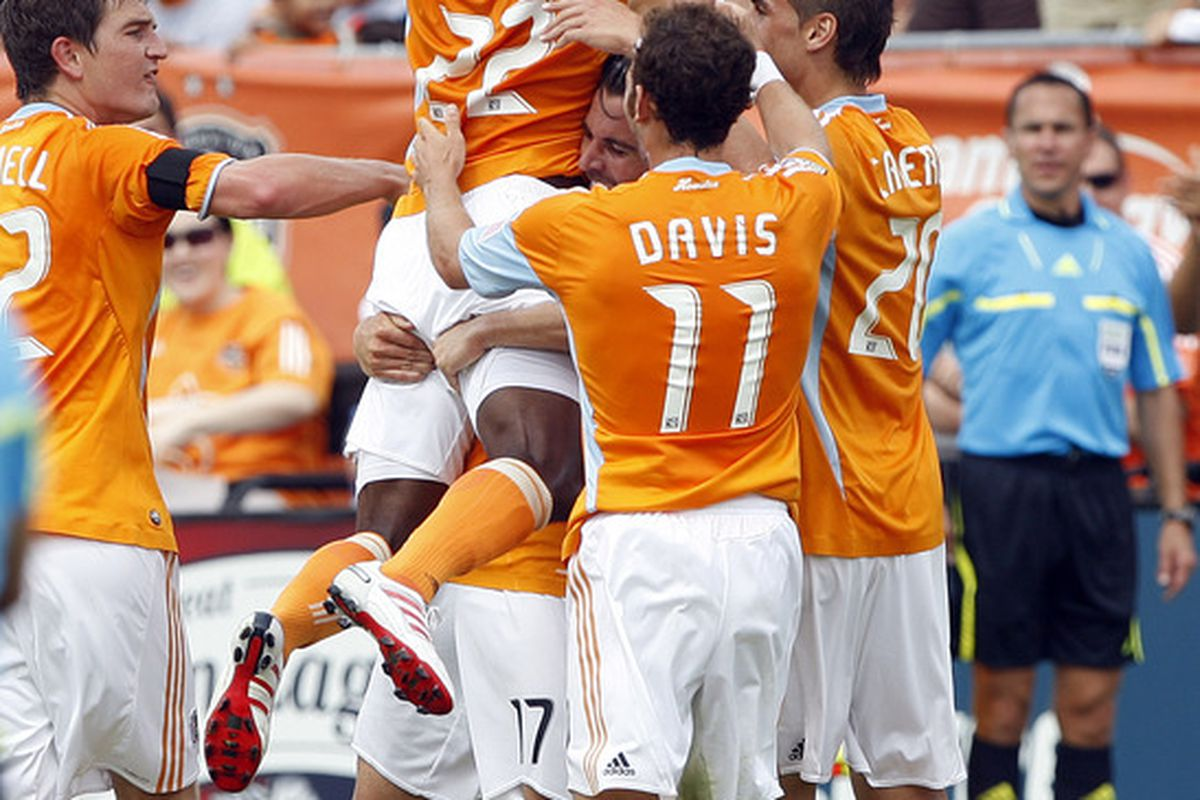 HOUSTON - APRIL 17:  Lovel Palmer #22 of the Houston Dynamo celebrates his first half goal with his teammates at Robertson Stadium on April 17, 2010 in Houston, Texas.  (Photo by Bob Levey/Getty Images)
