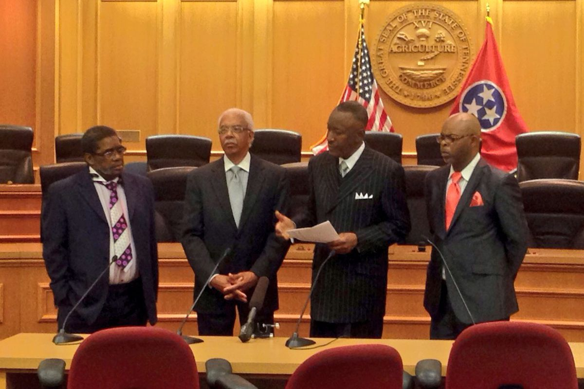 Pastors affiliated with the Memphis chapter of the Southern Christian Leadership Conference present a petition at the State Capitol supporting voucher legislation.