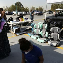 Parents and children receive instructions and new car seats during a drive-thru checkpoint at Shriners Hospitals for Children - Salt Lake City on Friday, Sept. 25, 2020. The checkpoint was an extension of the hospital's ongoing special needs car seat clinic, and a way to give back to the community.