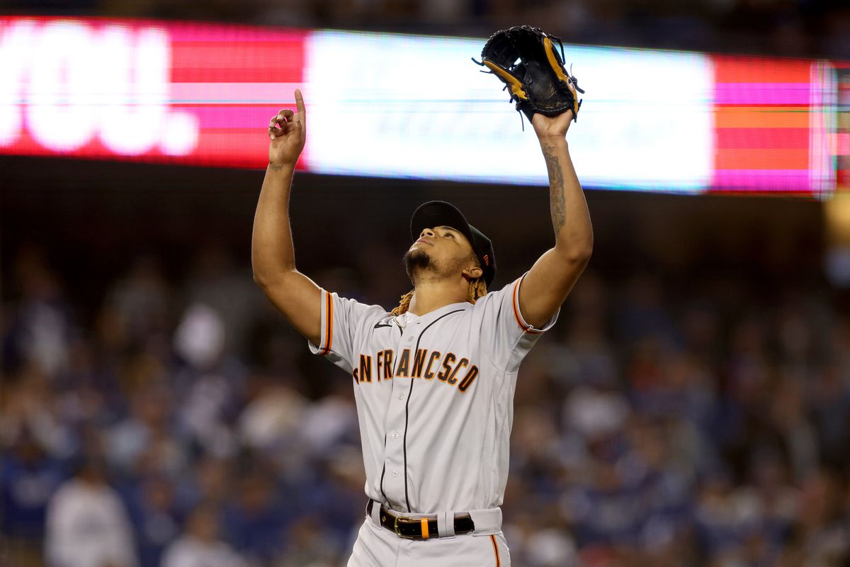 Camilo Doval of the San Francisco Giants celebrates an out against Justin Turner of the Los Angeles Dodgers to end the eighth inning in Game 3 of the National League Division Series at Dodger Stadium on October 11, 2021 in Los Angeles, California.