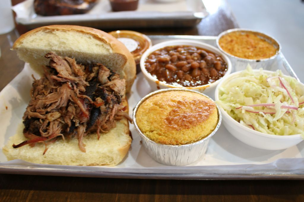 Pulled pork sandwich with sides of beans, mac and cheese, cornbread and coleslaw from Smoque BBQ. | Brian Rich/For the Sun-Times