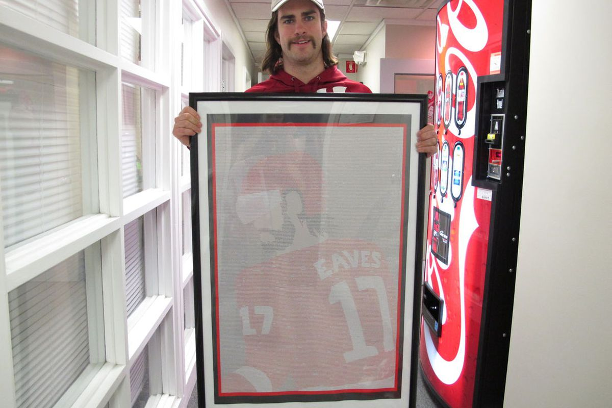Patrick Eaves shows off the poster Josh made of all the supportive comments from Wings fans to come out of Operation Eaves.
