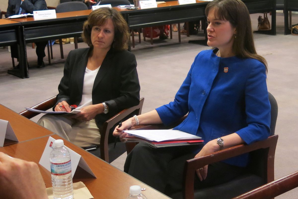 Education Commissioner Candice McQueen (right) talks with educators during a breakout session at the first testing task force meeting this year.