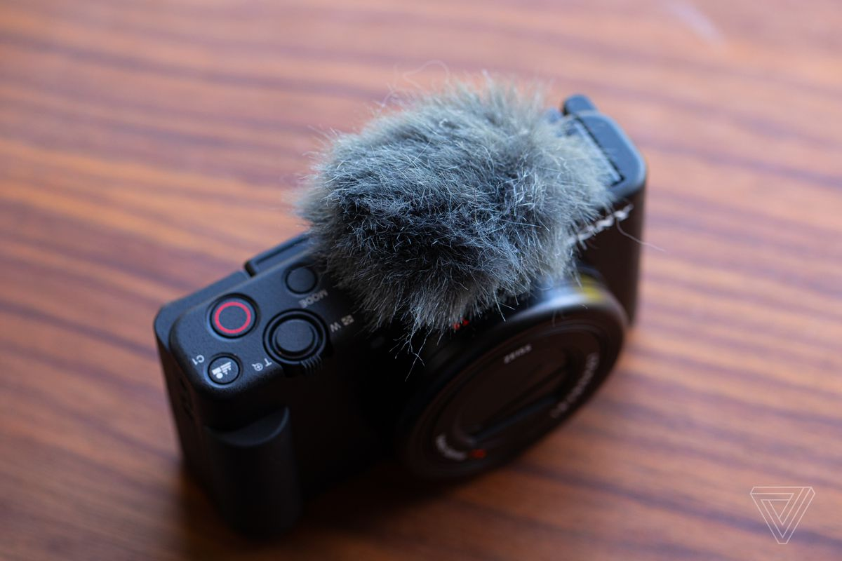The dead cat mic cover blocks the wind and mounts via the included hot shoe.