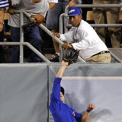 Chicago Cubs center fielder Sam Fuld robs Los Angeles Dodgers' Manny Ramirez of a home run during the eighth inning.