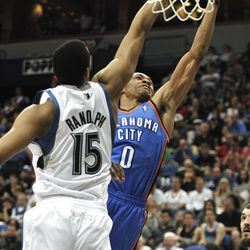 Oklahoma City Thunder's Russell Westbrook, rear, shoots as Minnesota Timberwolves' Anthony Randolph (15) attempts to defend in the third quarter of an NBA basketball game, Saturday, April 14, 2012, in Minneapolis. Westbrook finished with 35 points as Oklahoma City won 115-110. (AP Photo/Tom Olmscheid)
