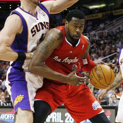 Los Angeles Clippers' DeAndre Jordan, right, backs down Phoenix Suns' Marcin Gortat, of Poland, during the first half of an NBA basketball game, Thursday, April 19, 2012, in Phoenix.