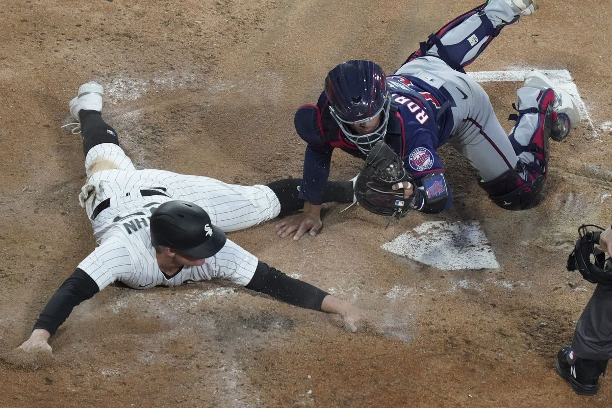 The White Sox' Andrew Vaughn is tagged out at home by Ben Rortvedt of the Twins during the second inning of Tuesday's game.