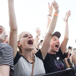 Taylor Evans, of Park City, center, and Molly Phillipps, 15, of Kaysville, scream as Nicholas Petricca from Walk the Moon takes the stage during the LoveLoud Festival at Utah Valley University on Saturday, Aug. 26, 2017, in Orem.
