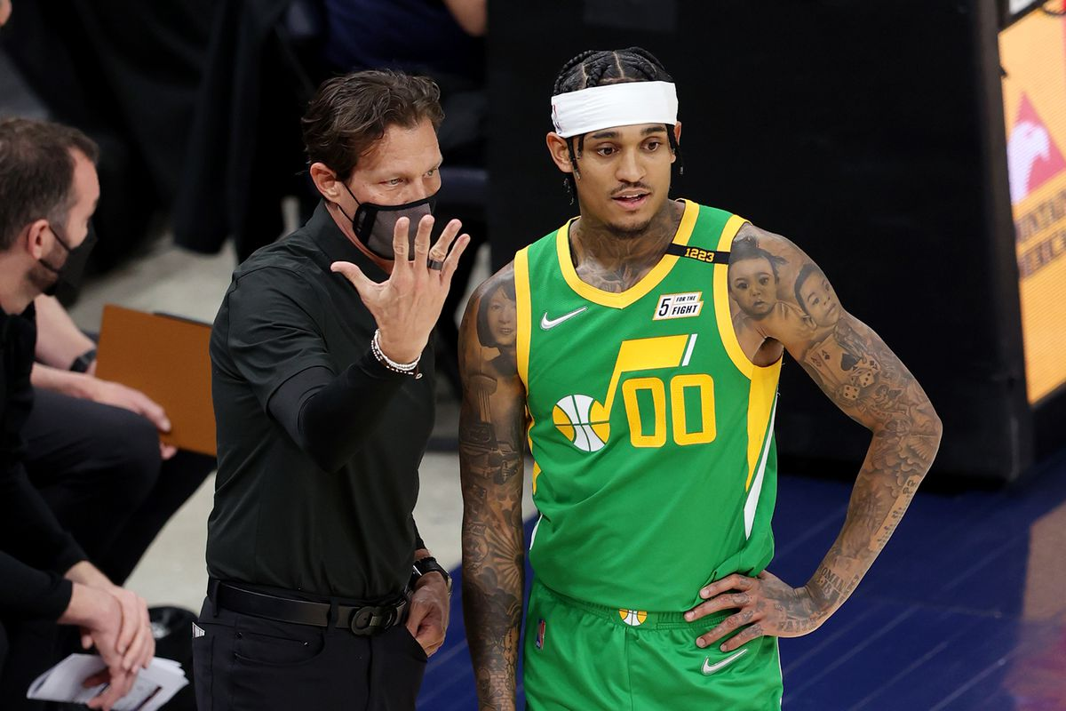 Utah Jazz coach Quin Snyder talks with Jordan Clarkson during a game against the Denver Nuggets at Vivint Arena in Salt Lake City.