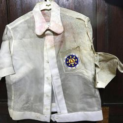 """In this photo taken Sept. 19, 2012, native Filipino attire called """"Barongs"""" which had been often worn in public during the two-decade rule of the late strongman Ferdinand Marcos, is revealed from a section of the National Museum in Manila, Philippines. Termites, storms and government neglect have damaged hundreds of pieces of Marcos' """"barongs"""" as well as former first lady Imelda Marcos's legendary stash of shoes, expensive gowns and other vanity possessions, which were left to oblivion after she and her dictator husband were driven to U.S. exile by a 1986 popular revolt."""