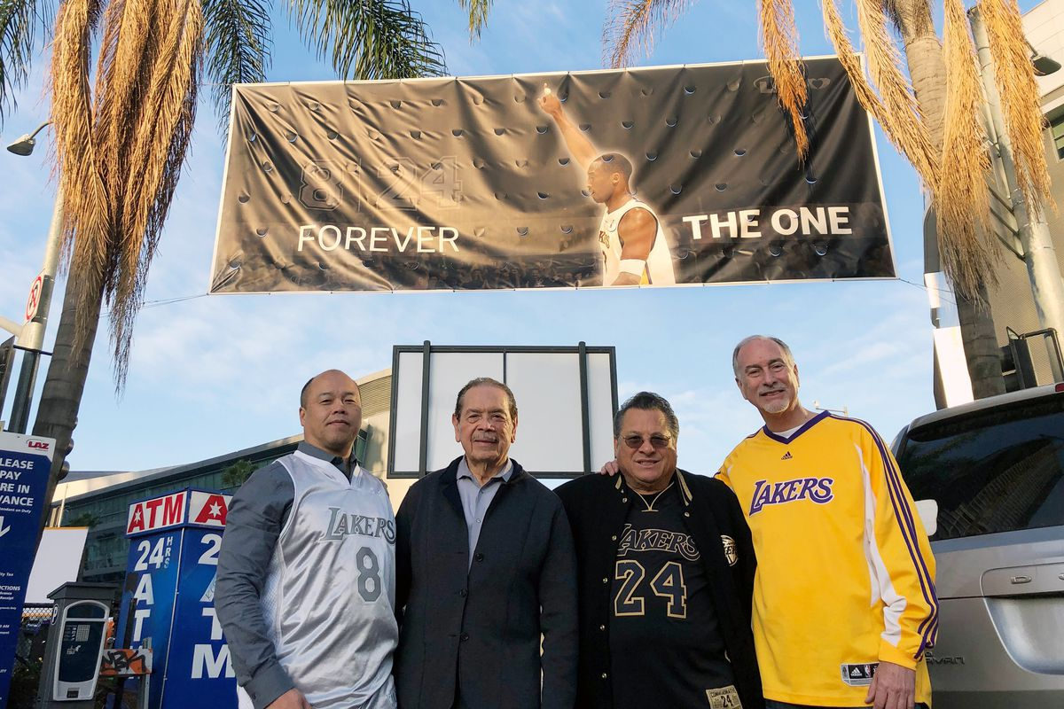 From left, friends Tom Ling, Rene Vega, Bob Melendez and Brett Noss pose outside Staples Center in Los Angeles before a public memorial for former Los Angeles Lakers star Kobe Bryant and his daughter, Gianna, in Los Angeles, Monday morning, Feb. 24, 2020. Melendez, 72, of Anaheim Hills, has been a season ticket holder for 40 years. (AP Photo/Stefanie Dazio)