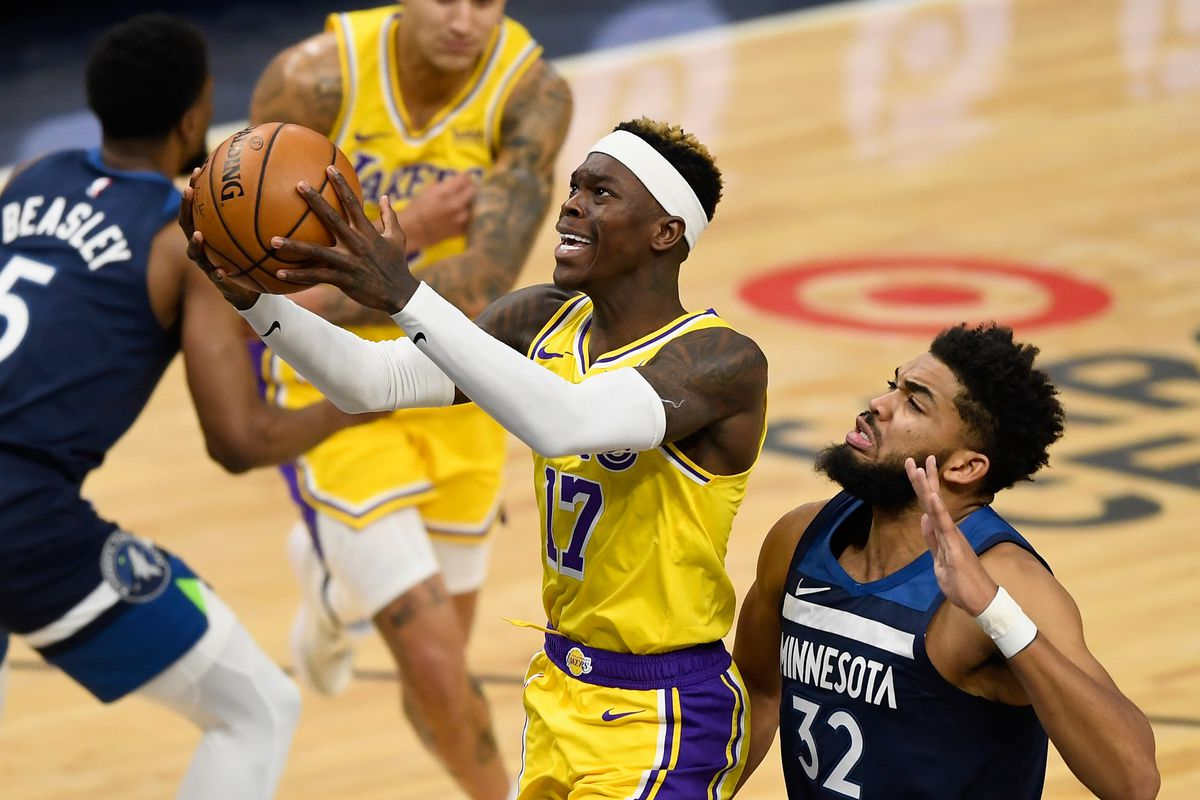 Dennis Schroder of the Los Angeles Lakers shoots the ball against Karl-Anthony Towns of the Minnesota Timberwolves during the first quarter at Target Center on February 16, 2021 in Minneapolis, Minnesota.