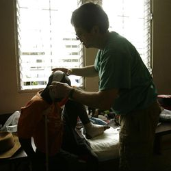 Dr. Mark Rampton works on a young boy's injuries at a clinic in Port Au Prince, Haiti, Tuesday, Jan. 26, 2010.