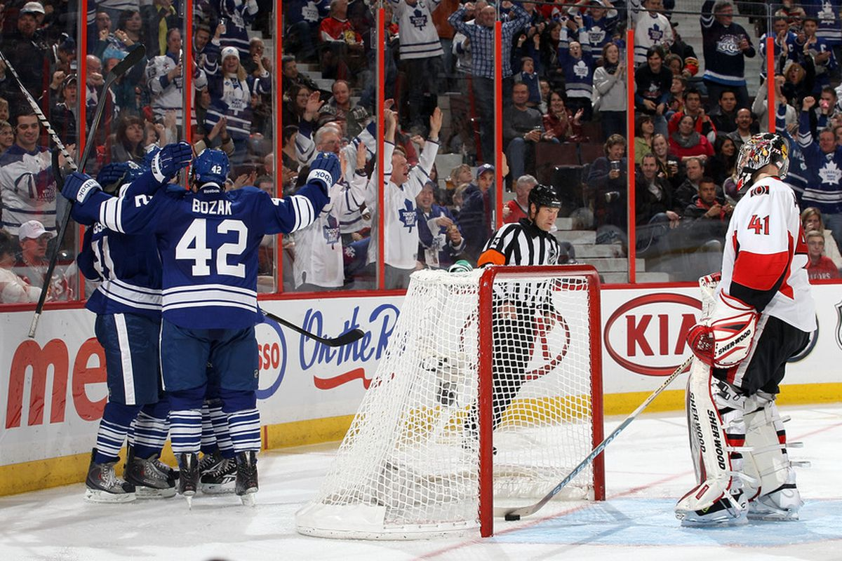 How many Leafs jerseys are there compared to Sens jersey in this picture? (Photo by Jana Chytilova/Freestyle Photography/Getty Images)