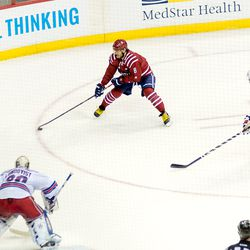 Ovechkin Collects Puck Deep in Rangers Zone