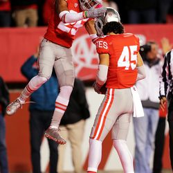 Utah Utes wide receiver Jaylen Dixon (25) jumps as he celebrates with Utah Utes wide receiver Samson Nacua (45) as Nacua scores a touchdown as Utah and UCLA play a college football game in Salt Lake City at Rice-Eccles Stadium on Saturday, Nov. 16, 2019. Utah won 49-3.