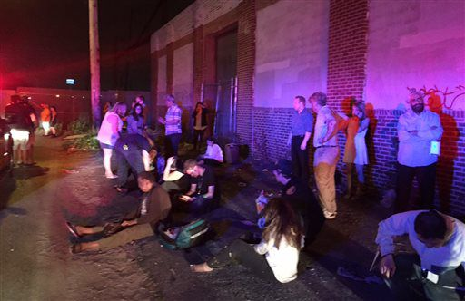 <small><strong>Passengers gather near the scene of an Amtrak train derailment Tuesday night in Philadelphia. Train 188 was traveling from Washington to New York City. | Paul Cheung/AP</strong></small>
