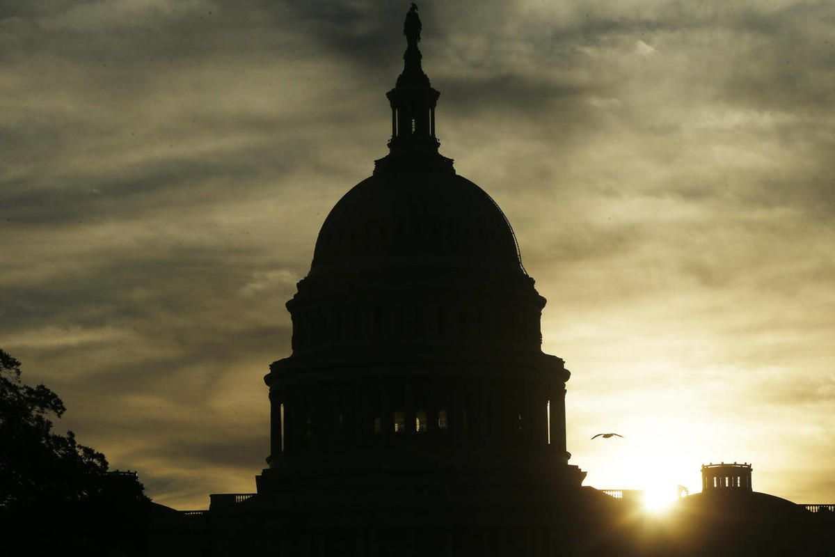 The sun rises over the U.S. Capitol. Their power ebbing, Senate Democrats launched a last-minute drive Saturday to confirm roughly 20 of President Barack Obama's nominees, and several Republicans blamed tea party-backed Texas Sen. Ted Cruz for creating an