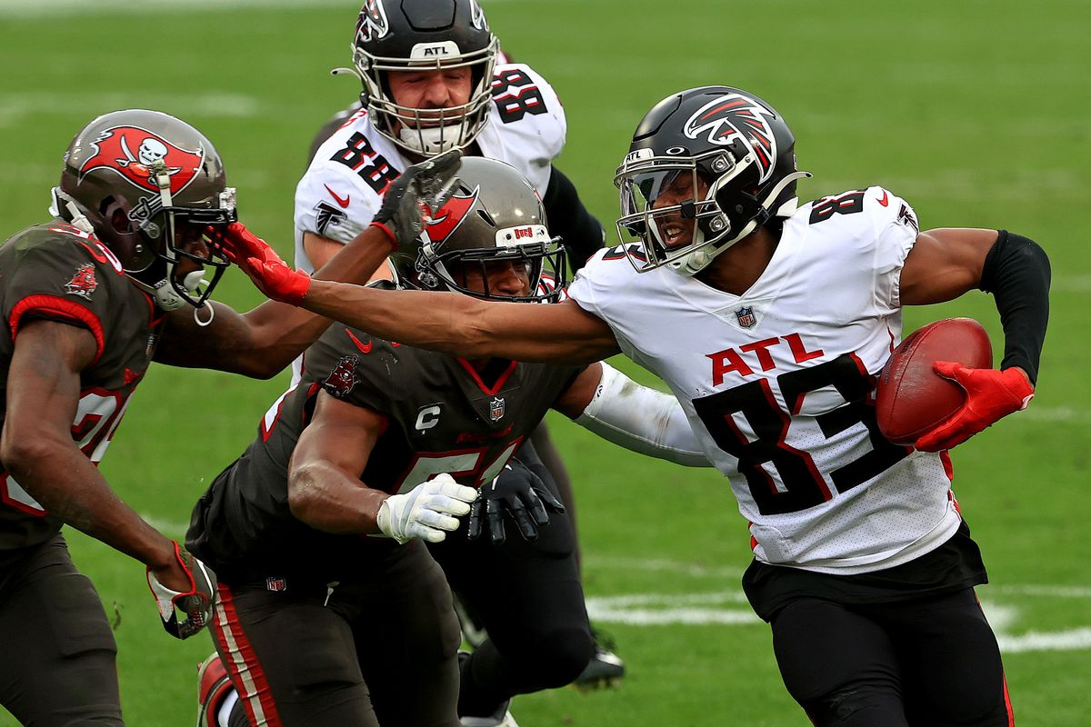Russell Gage #83 of the Atlanta Falcons runs after a catch during a game at Raymond James Stadium on January 03, 2021 in Tampa, Florida.
