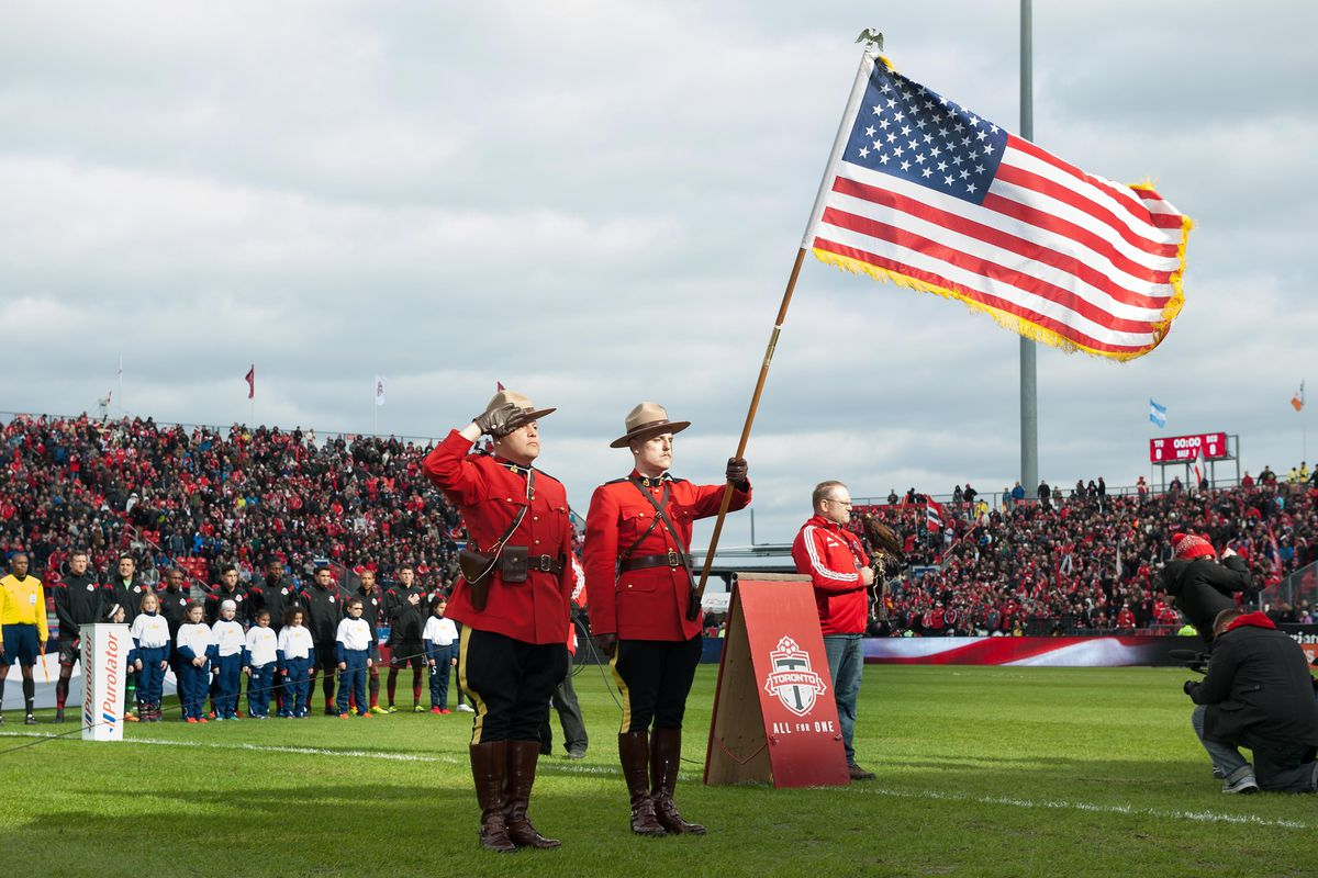 For no real reason, here's a picture of Canadian Mounties holding an American flag.