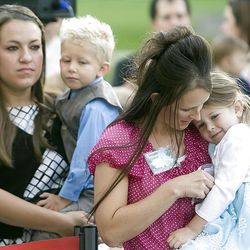Nancy Smith holds her nephew Bryson Wight and Leah Wilson holds her daughter Lydia as they join about 200 at the cornerstone ceremony at the Brigham City Temple prior to the dedication Sunday, Sept. 23, 2012.