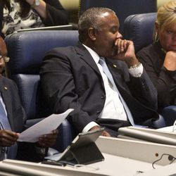 Sen. Quinton Ross, D-Montgomery, center, talks with Sen. Harri Anne Smith, I-Slocumb, during the Senate session at the Alabama Statehouse in Montgomery, Ala., Thursday, April 19, 2012. At left is Sen. Bobby Singleton, D-Greensboro. The Alabama House and Senate are looking for a compromise on their different versions of a bill to tie legislators' pay to the state's median household income. The House voted 77-8 Thursday and the Senate voted 30-2 to send the pay bill to a conference committee of six legislators to seek a compromise.
