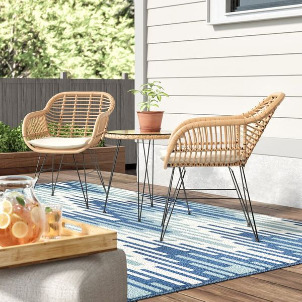 2 wicker chairs and table on patio