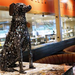 A dog statue made from dog bones.